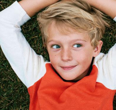 Boy lying on grass