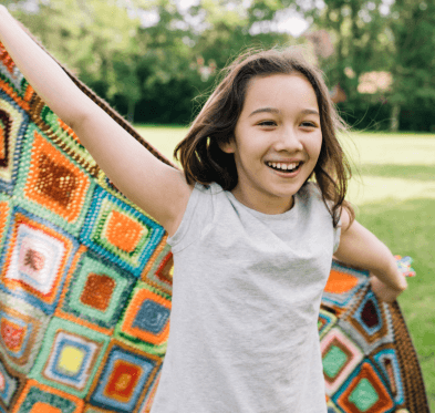Girl with quilt cape
